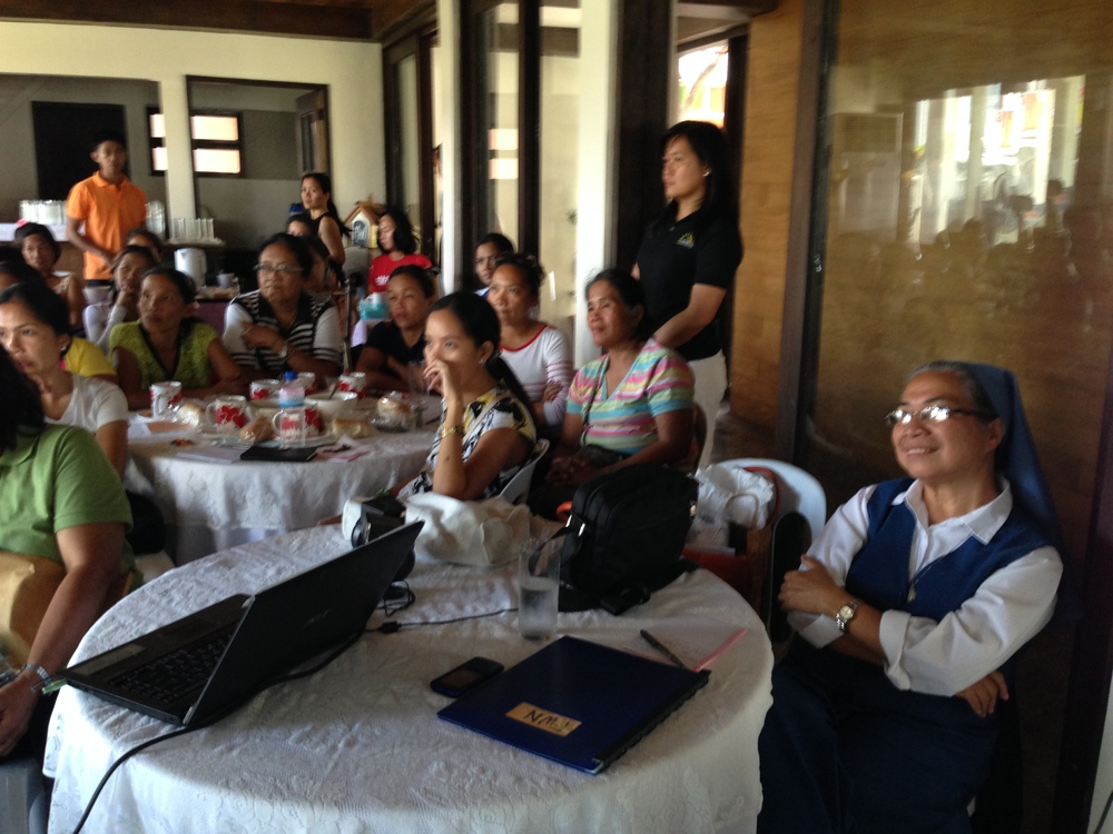 Tacloban City Women Survivors intently paying attention to the details of the Micro Finance Programs.