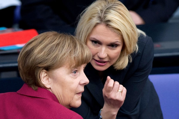 Chancellor Angela Merkel, left, and Manuela Schwesig, the minister of family affairs who helped a law requiring more women on corporate boards clear legal and political hurdles in Germany. Photo Credit Soeren Stache/European Pressphoto Agency