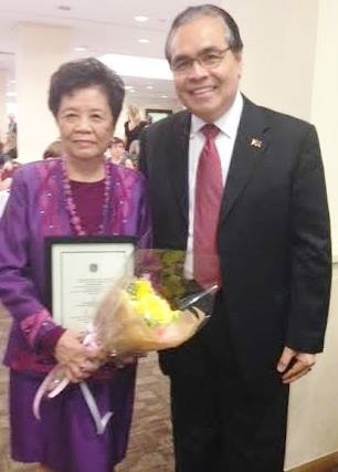 Dr. Connie S. Uy with Consul General Mario de Leon.  Photo credit:  GMA Network