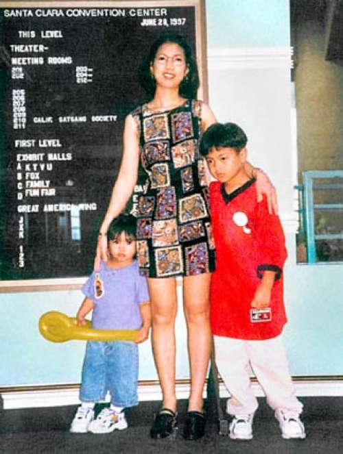 Claire Joyce Tempongko pictured with her two young children.