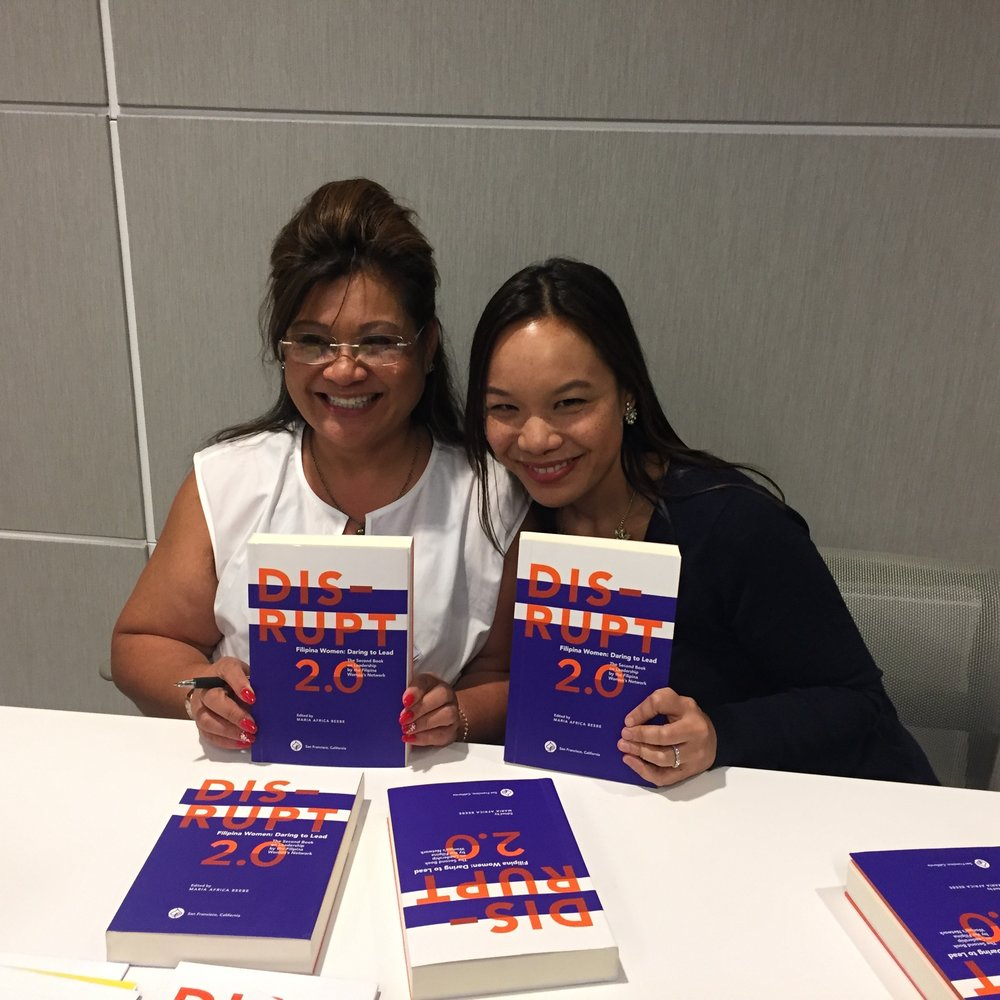We're published! Authors Elizabeth Bautista (Global FWN100™ '15) and Melissa Orquiza (Global FWN100™ '15) proudly showing DISRUPT 2.0 at the author signing table at DISRUPTing SF, Oct. 6, 2016.