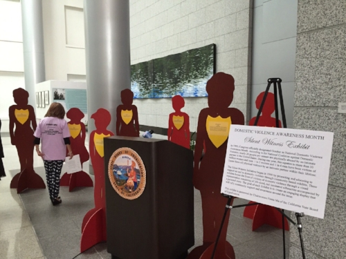 FWN Board Member Amar Bornkamp reads the personal accounts of survivors of domestic violence at the Silent Witness Exhibit in the Capitol Building for Domestic Violence Awareness Month, Oct. 6, 2016.