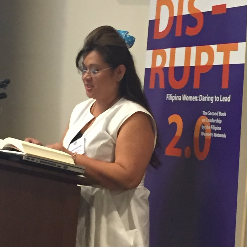 "Elizabeth Bautista (Global FWN100™ '15) reads from her chapter ""Synergistic Change"" at DISRUPTing San Francisco at Charles Schwab on October 6, 2016. Elizabeth recently led a remote book reading at DISRUPTing Houston live from the Grace Hopper Celebration of Women in Computing in Houston Conference via Zoom.us on October 20."