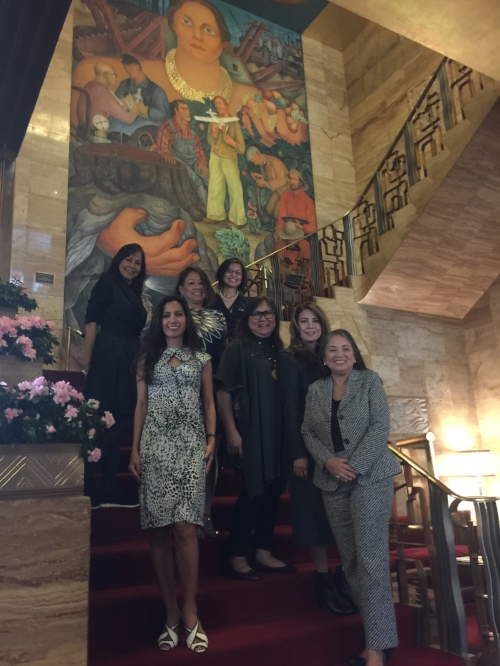 "Filipina Influentials pictured on a stairwell flanked by Diego Rivera's 1931 fresco ""Allegory of California"" at City Club SF after the MeetUp Breakfast on November 15, 2016."