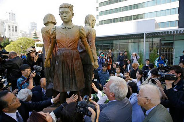 Memorial to WWII Comfort Women in San Francisco. The Filipina girl with a scarf represents Filipina comfort women during World War II in the Philippines.
