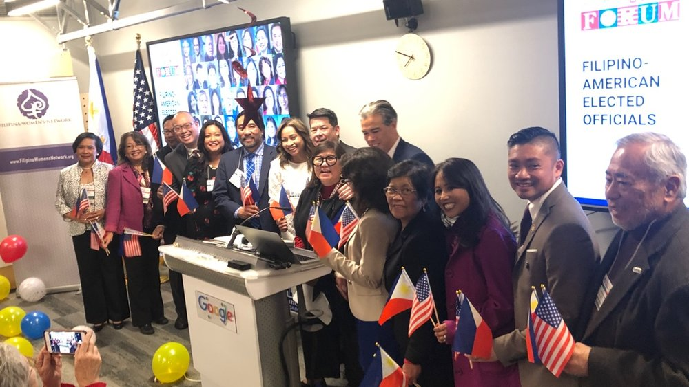 Marily Mondejar (at podium with glasses) is flanked by Filipino Americans recently elected during the mid-term 2018 U.S. elections. At the Fil-Am Victory Celebration on January 31, 2019 in San Francisco hosted by Filipino American Community Forum. (Photo: Filipina Women's Network)