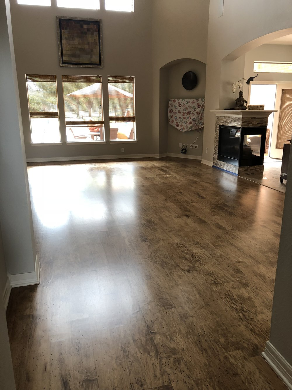 Engineered Hickory Wood FLOORING - We completely sanded resurface and restored this 3/8 inch prefinished engineered hardwood floor in Cinco Ranch.