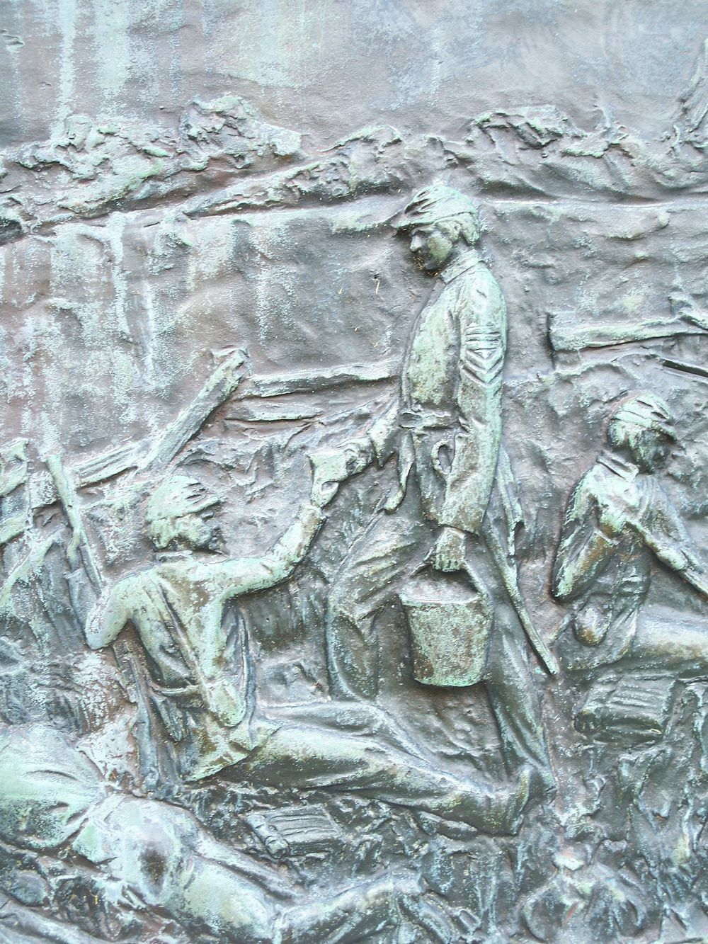 This relief tablet depicts McKinley bringing coffee to tired and wounded solders during the battle.