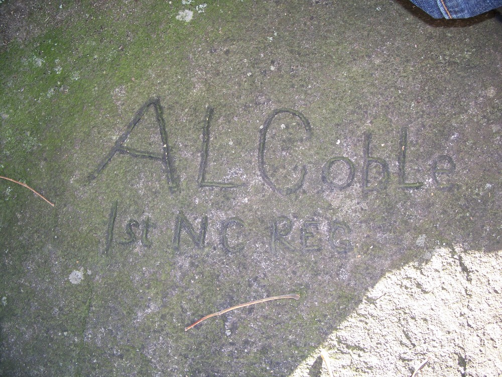 hidden among the rocks at culp's hill is this soldier graffiti.