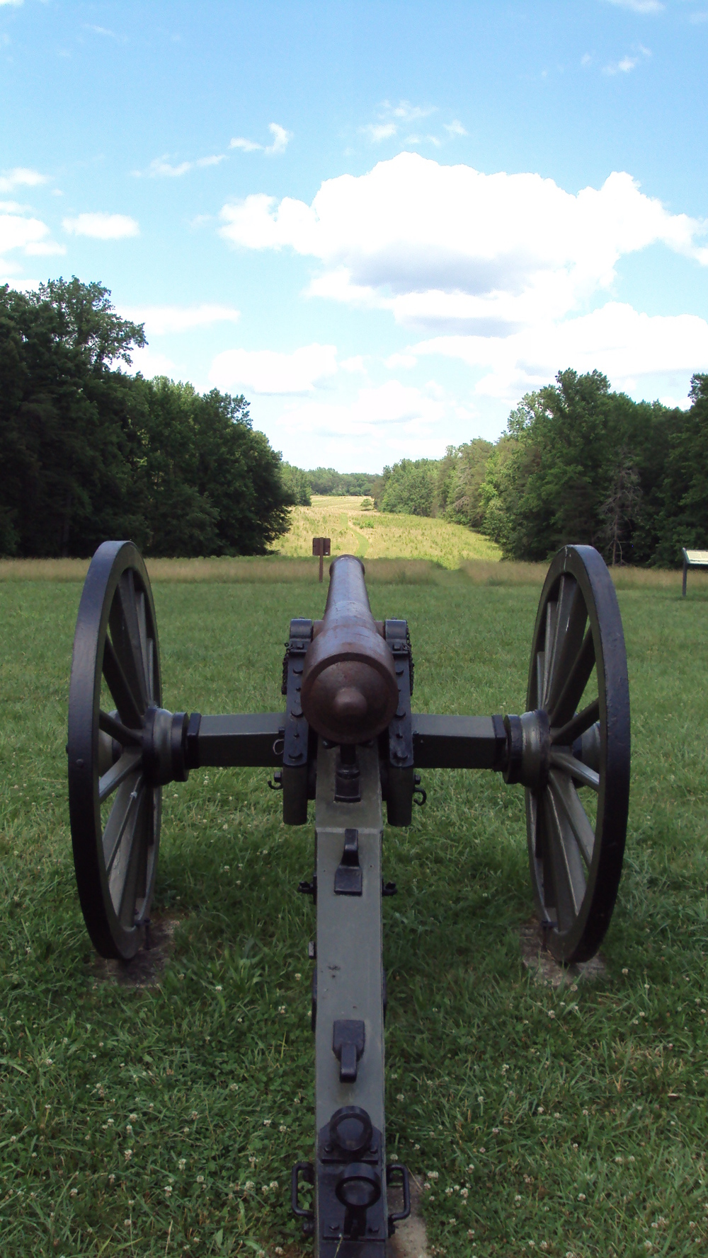 A cannon rests today atop Hazel Grove, the High Ground of the CHancellorsville Battlefield.  In the distance can be Seen Fairview, the Union artillery position on May 3rd; off to the Right of Fairview lie the remains of the Chancellor House, General Hooker's Headquarters