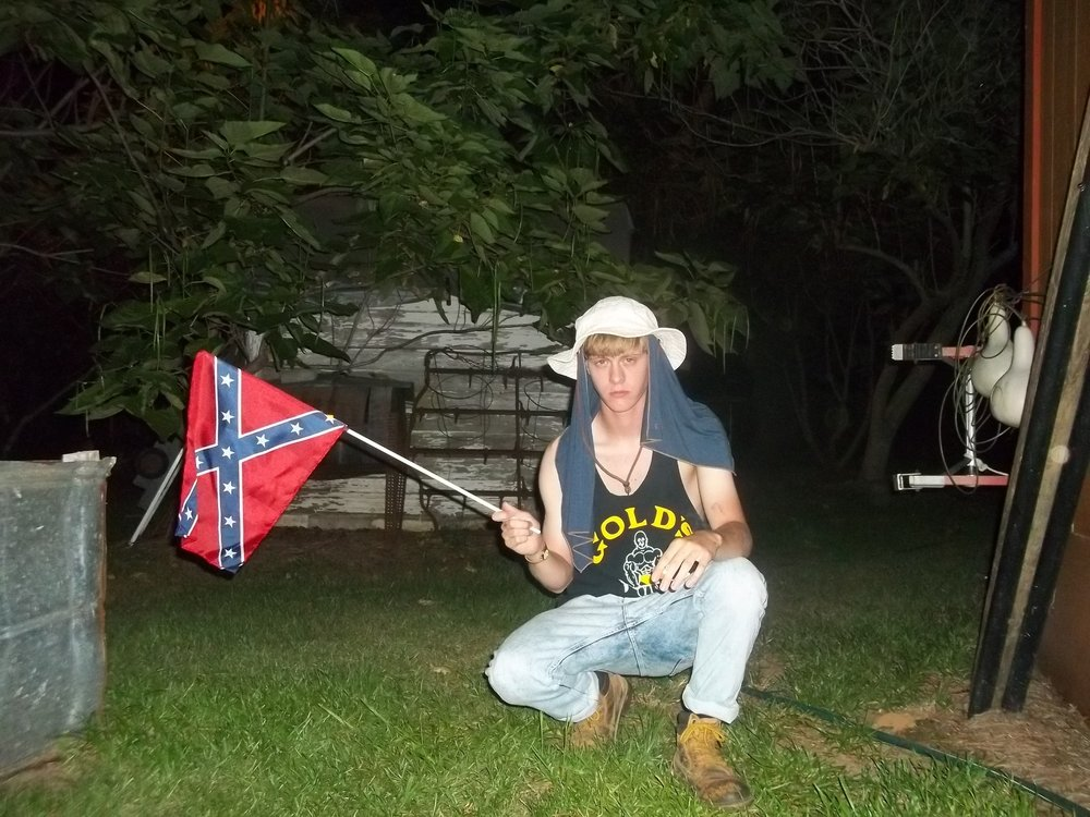 Dylann Roof poses with a Confederate flag, which has been at the center of national scrutiny for the past several days.