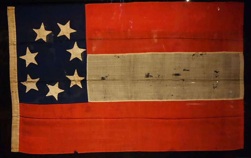 "THe first Confederate national flag, known as the ""Stars and Bars"""