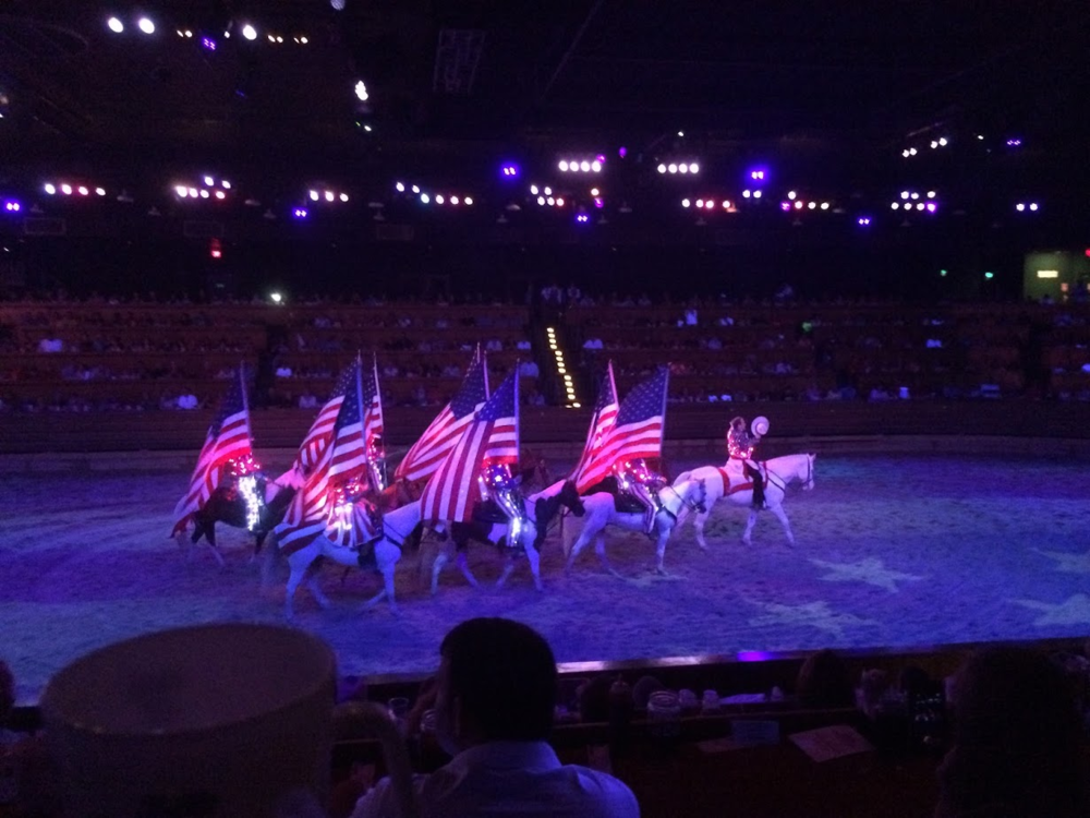 Competitors from both sides - North and South - end the night's events carrying American flags.