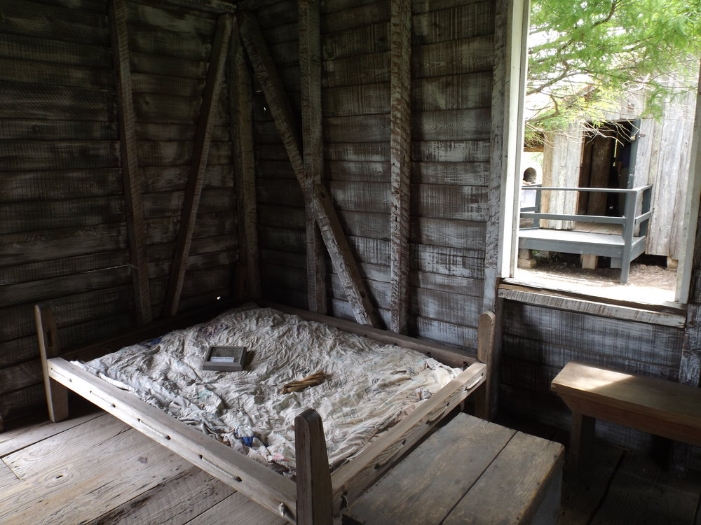 Part of a cabin set up to show living quarters during slavery.