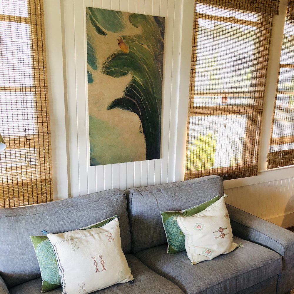 """I love how Jill worked this art piece she loved into her home. If you look closely, it's hardly noticeable, but the picture was created to be viewed horizontally. However due to lack of wall space above the couch, Jill just made it work and turned it vertically! - Design often takes time to fit all the pieces together. Be patient and """"listen"""" to what the room and your belongings are telling you to do!"""