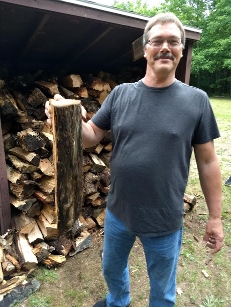 Todd doing his part stacking wood.