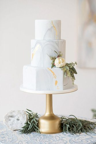 marble-wedding-cakes-three-tiered-with-golden-elements-and-a-delicate-white-flower-with-greens-elegant-wedding-magazine-via-instagram-334x500 2.jpg