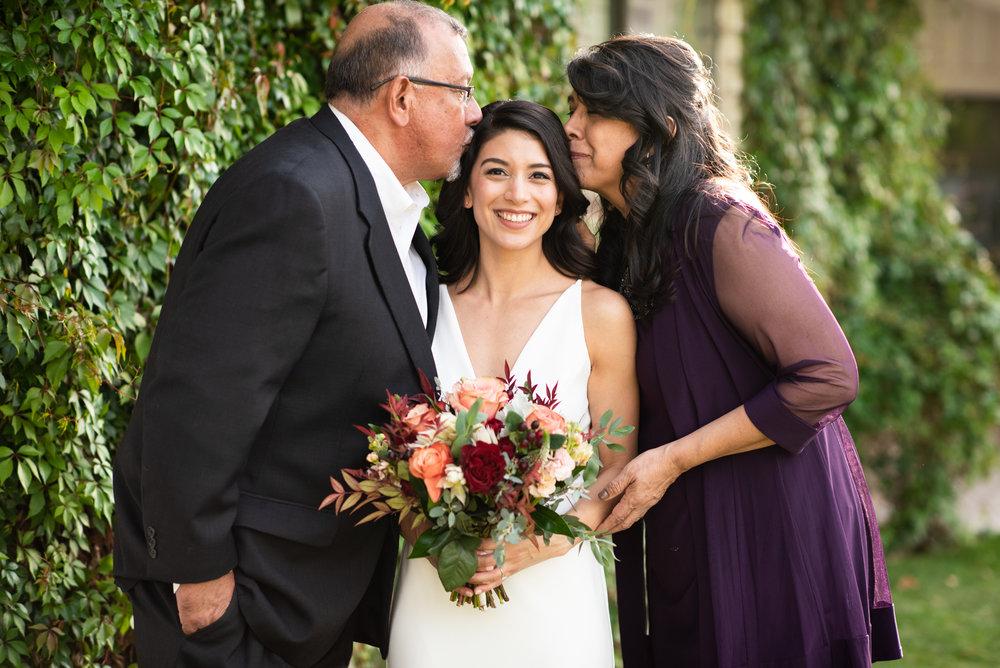 bride-parents-kiss.jpg