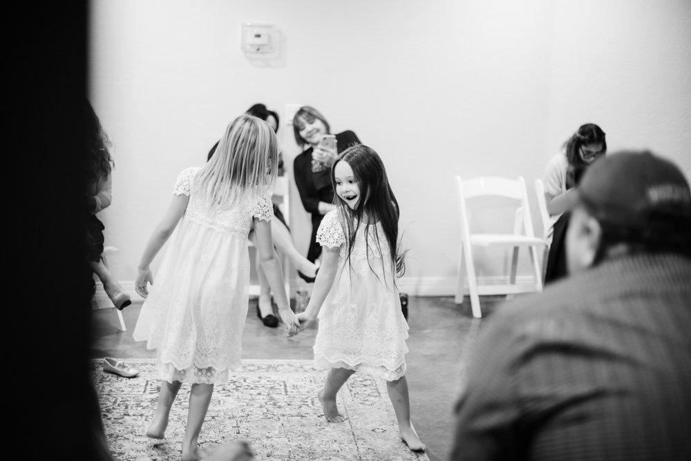 flowergirls-dancing-candidweddingphotos.jpg