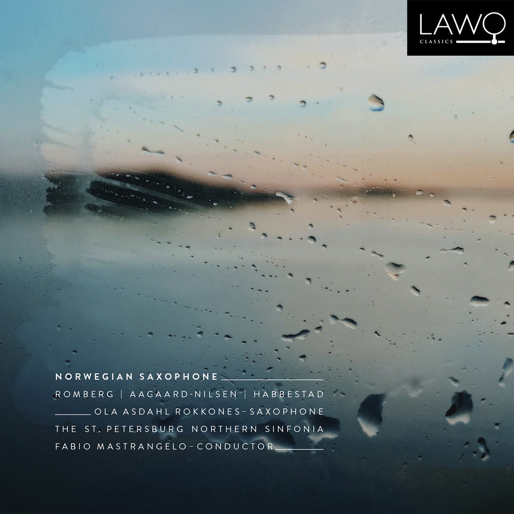 "Norwegian Saxophone - LAWO Classics - 2018Norwegian saxophone is the first classical album from the versatile artist Ola Asdahl Rokkones, containing three world premiere recordings. Recorded in the legendary LENDOK Studios in Saint Petersburg, together with conductor Fabio Mastrangelo and The St. Petersburg Northern Sinfonia, this is a unique release of new Norwegian music for saxophone and orchestra.""The Tale of Taliesin"" by Martin Romberg (2009), ""Bør"" by Torstein Aagaard-Nilsen (2014) and ""Un rêve Norvégien"" by Kjell Habbestad (2002/2015) have all been commissioned by Rokkones. Although the composers have been inspired by literary works, the music showcases the classical saxophone in three very different musical surroundings. With the saxophone as a narrator, we explore the ancient Celtic legend about Taliesin in a large orchestral work, the existentialistic poem ""Bør"" by Stein Mehren in a contemporary and experimental soundscape, and finally the famous visionary poem ""Draumkvedet"" where folkloristic elements fuse with a modern classical orchestral treatment.Following a long and twisted path, this recording is the result of a process that has taken many years – for Rokkones' part almost half a lifetime, as he commissioned the first work in 2001 at the age of 18.Ola Asdahl Rokkones - alto saxophoneFabio Mastrangelo - conductorThe St. Petersburg Northern SinfoniaFind the album on iTunes here.Find the booklet here."