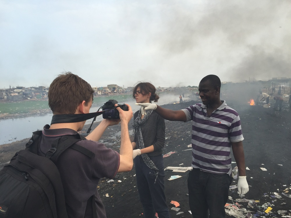 At the burning site at Agbogbloshie with (from left) Huw P-W, Markella Koniordou, and Sampson Atiemo.