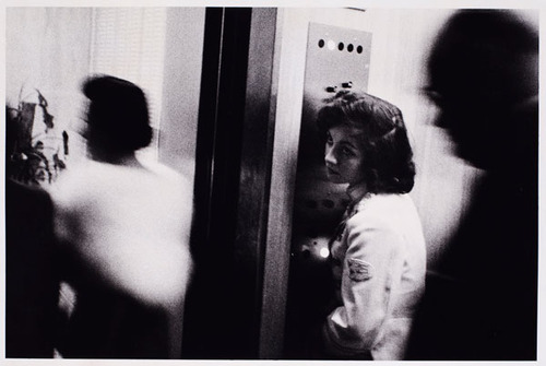 "Elevator-Time Machine?                Robert Frank,      Elevator—Miami Beach   , 1955; gelatin silver print; 12 3/8 × 18 13/16 in.; Collection Philadelphia Museum of Art, purchased with funds contributed by Dorothy Norman, 1969; © Robert Frank As I was reading about the photographer Robert Frank, I came across   this article    that tells a remarkable story about the girl in Frank's famous photograph 'Elevator - Miami Beach, 1955'.  Jack Kerouac wrote of this girl in his introduction to 'The Americans': ""That little ole lonely elevator girl looking up sighing in an elevator full of blurred demons, what's her name & address?"".    Photographers don't write down the names of all the people they photograph, so Kerouac did never find out her name.  He would have now though, 50 years later…"