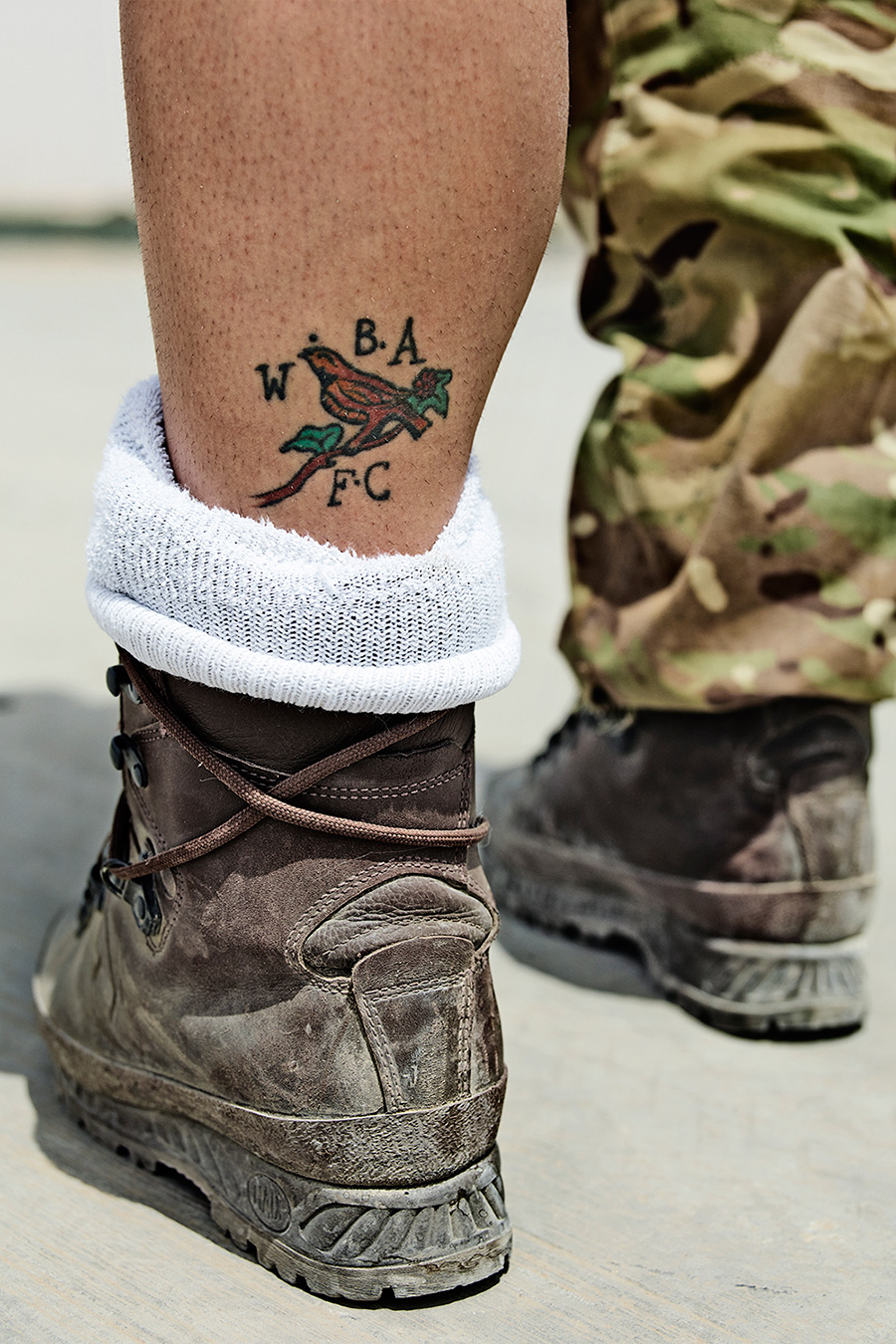 "6 SHEET IN SANDWELL, WEST BROMWICH Many of the troops use tattoos to remind themselves of loved ones back home. The girl who this tattoo belongs to wasn't too keen on having her portrait taken, but was very happy to show me her love of ""The Baggies""."