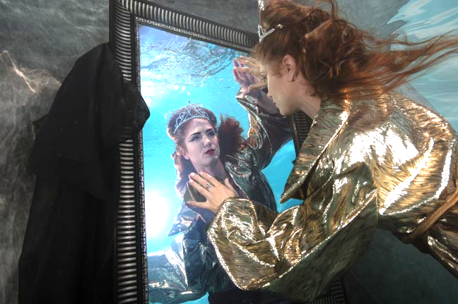 Evil Queen underwater with a mirror and backdrop.