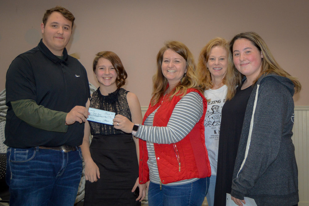 Mandi Curtwright, Main Street Batesville Executive Director, & Suzanne Magouyrk, Main Street Batesville Board Chair, are joined with members of the L-U ARK 4H Club during a check presentation of $350 at a recent board meeting.