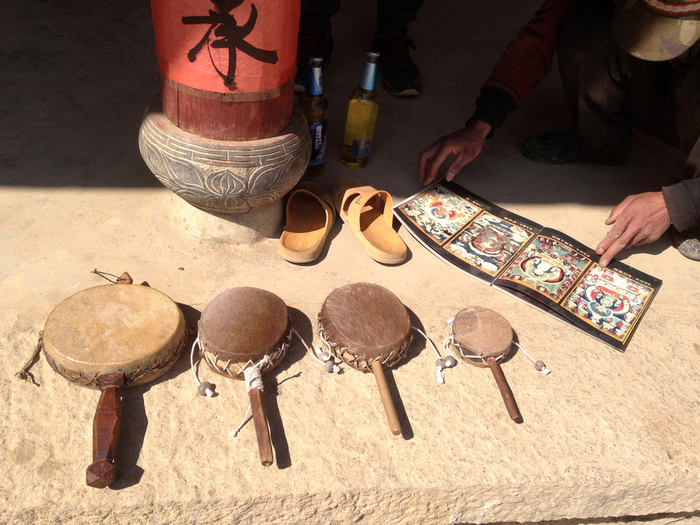 Three Aztlan-Shangrila calfskin drums with Dongba Yanjiahua's goatskin drum (far left).
