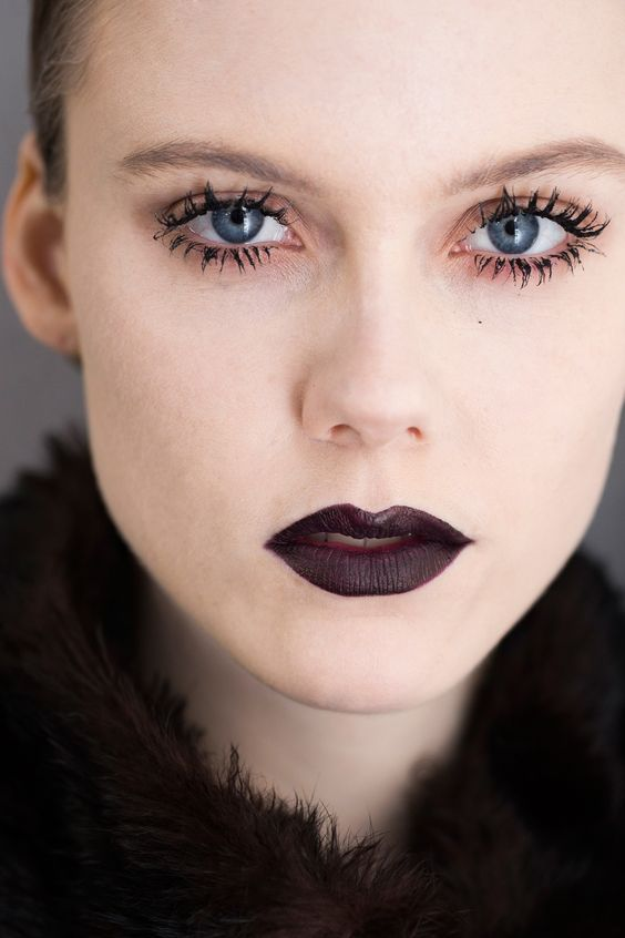 Clumpy mascara and vampy goth lips