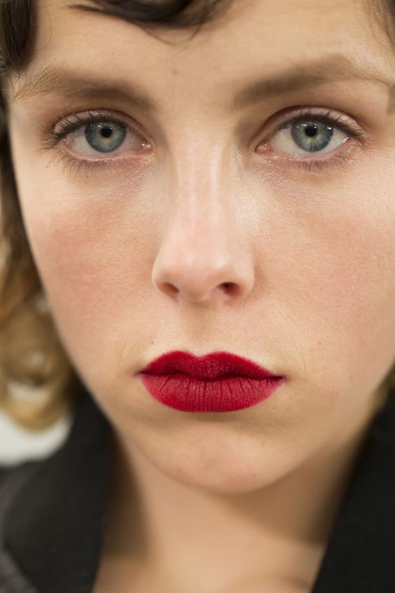 Miminal eyes with classic scarlet lips at Prada