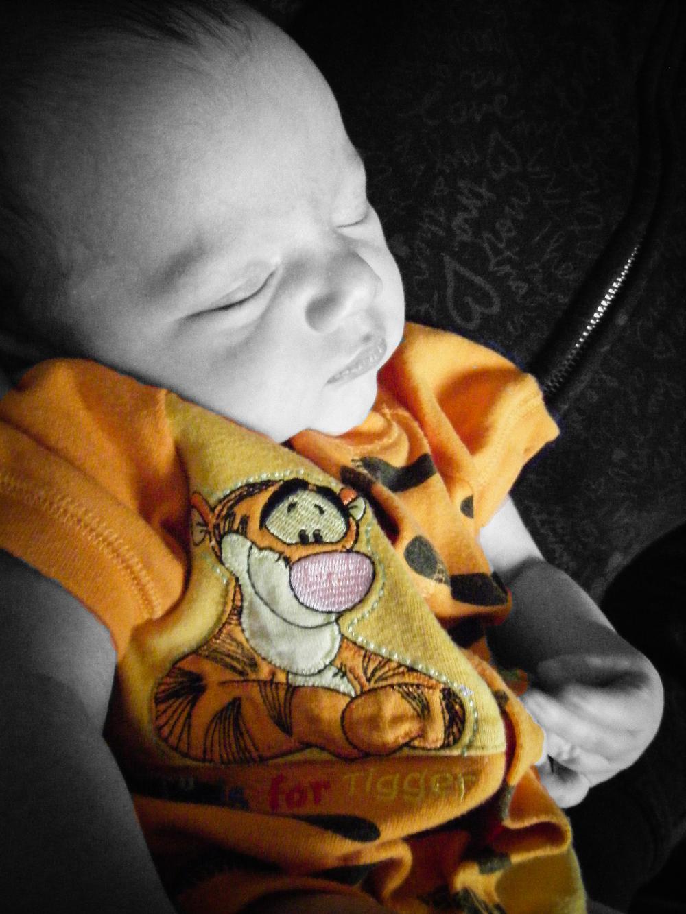 baby-wearing-an-orange-tigger-onesie.jpg