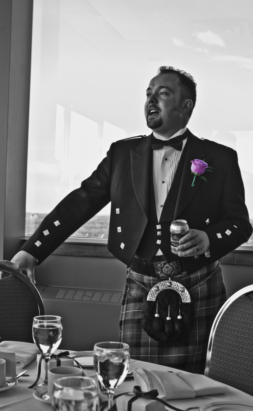 calgary-wedding-groom-with-a-pink-rose-corsage-and-plaid-kilt.jpg