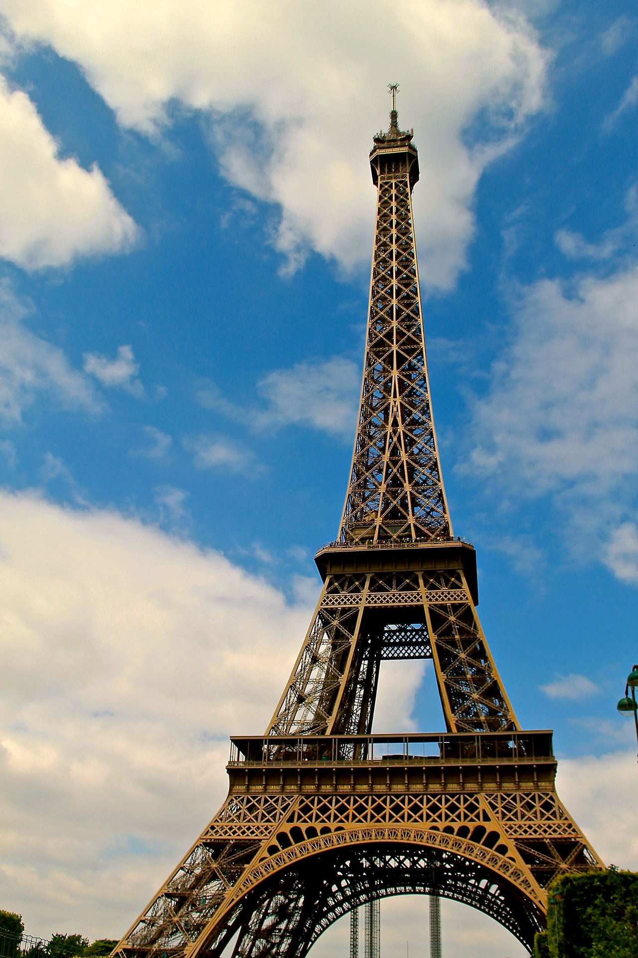 "our-world-in-words :      The Eiffel Tower, France                     Ahh Pareee! To save a little bit of money, Megan and I decided to try out ""Couch Surfing,"" which is an online community of travelers that allow for other travelers to sleep on their couches around the world. I know it sounds pretty strange, but I was recommended to the site about six months ago by another traveller friend and so far have had great success! Each host has a profile on the site with reviews from all their past guests, and pictures of the area they live and their spare bedroom or couch. We stayed with a wonderful man, named Clement, who lived about fifteen minutes walking distance from the Eiffel Tower. He is a frequent host, and we met two other surfers as we were leaving. We arrived in the late afternoon and spent the remainder of the day adjusting, resting, and walking through town. The next day we woke up bright and early and relaxed; all ready to go! We hopped on a metro and went to the Eiffel Tower and an exhibit about the Beatles at the Four Seasons, where they stayed in the seventies, and where Clement currently works. Then we wandered around for hours seeing the Notre Dame, the Arch de Triumph, the Pont d'arts (also called the Lover's Bridge), and Victor Hugo's house. Then we attempted to find the Bastille…I say attempted because after walking past it at least a dozen times we finally asked someone where it was, only to realize that the Bastille is not a  building , but rather and entire area with a monument in the middle. (How did they storm that!?) We continued on and saw street performers, ate more ice cream and crepes, rode in a ""cycle-politian,"" which is a little cart attached to a bike that pulls you around the city. We ate in a tiny café by Victor Hugo's house and then headed back to Clement's to get ready to go out. He had other couch surfers staying our second night, so we switched to a different apartment with a guy named Jeremy, who lived about ten minutes away and works in Versailles for the company that produces World of Warcraft and other games. The group of us, hosts and guests alike, piled in a cab and headed to the Eiffel Tower where we sat on the grass and drank wine and enjoyed the gorgeous lights at night. We then attempted to go to some bars that were once Speakeasys, but they were all closed and so we headed home to fall asleep."