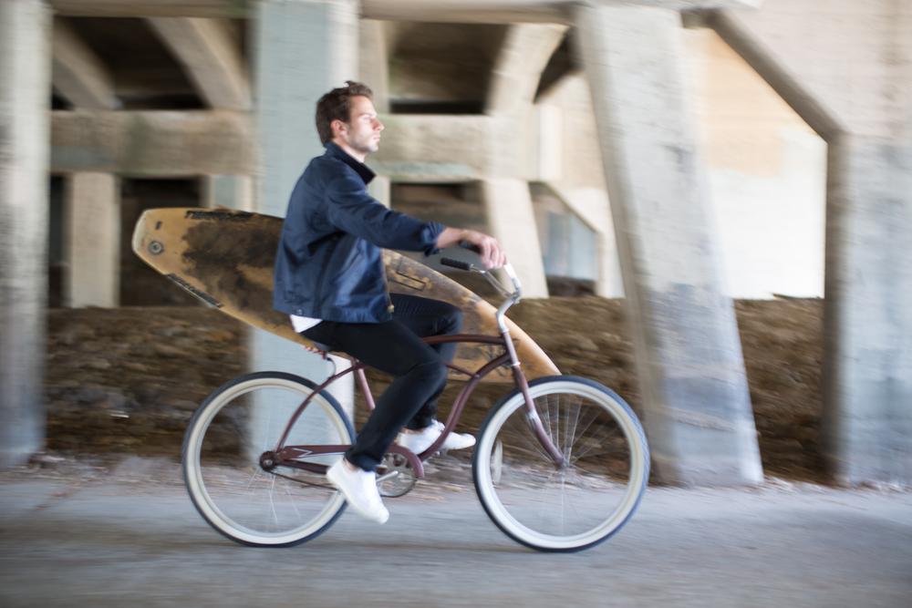 Dean in blue jacket riding bike.jpg