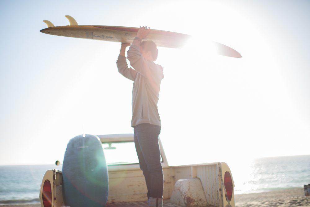 paul holding surfboard on his head.jpg