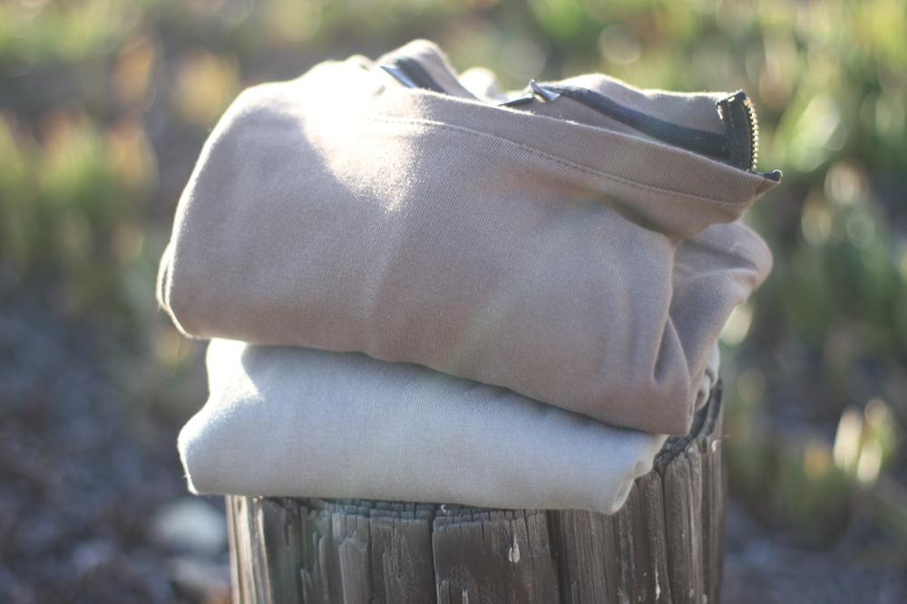 Pullover stack on stump on beach.JPG