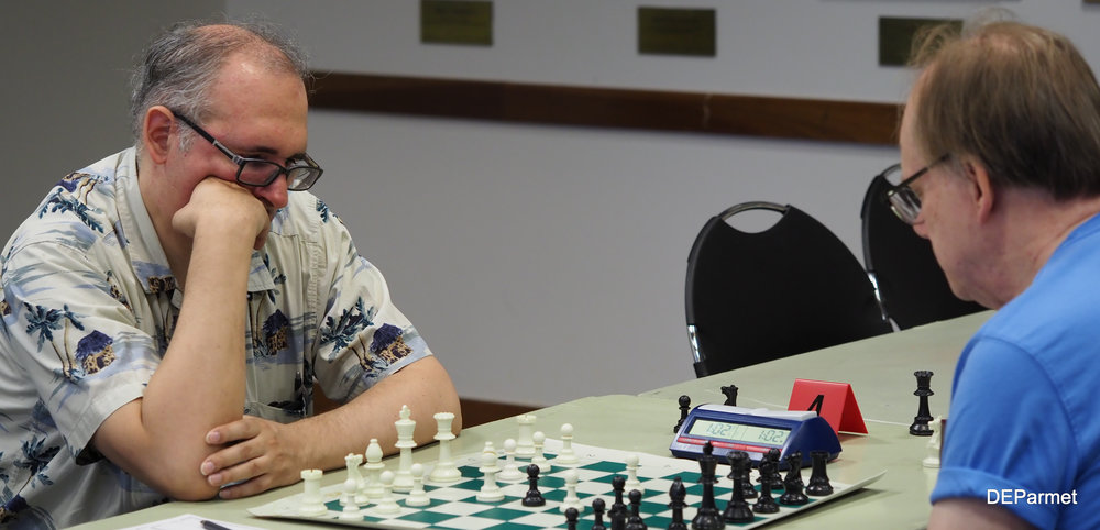 A classic Chicago matchup: NM Steve Szpisjak faces off against Steinitz's wildest disciple, Bill Smythe.