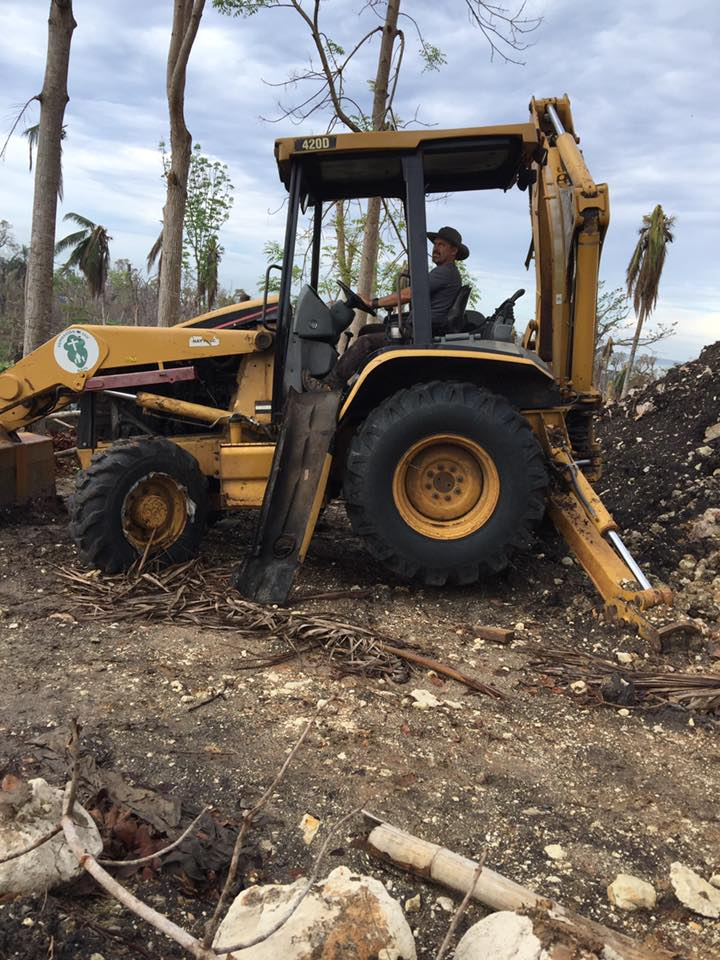 Clearing the roadway. Being able to use the repaired backhoe saved tons of time and enabled access not only for our team, but many other!