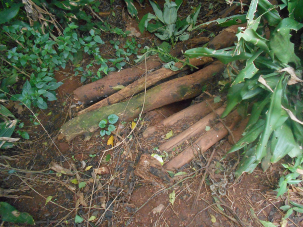 Before having a proper Pit Latrine built for an HIV+ mother, this was what she had to use along with her 4 children.