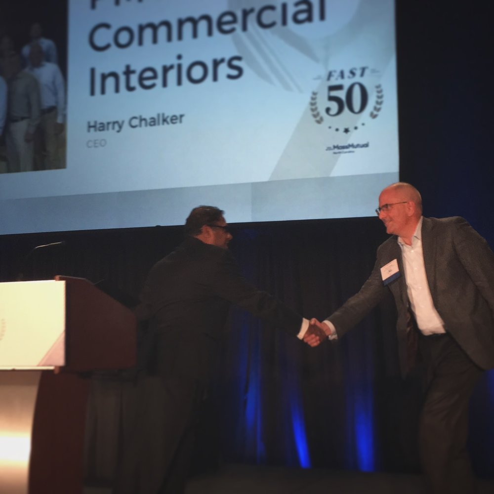 Harry Chalker, CEO accepting the 2017 TBJ Fast 50 Award.