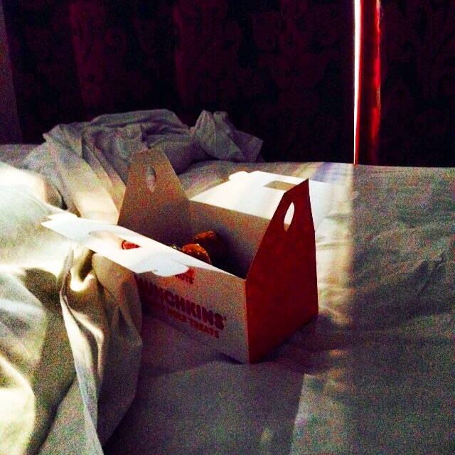 This is how the morning began... Donuts in a comfy hotel bed..