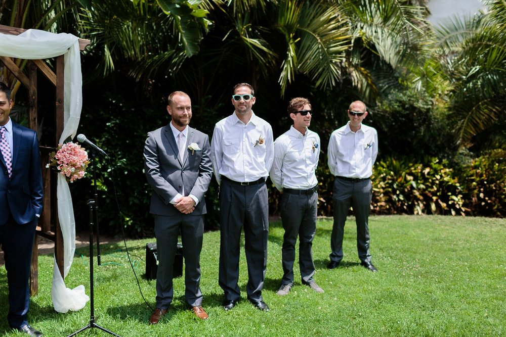 groomsmen at altar sunken gardens wedding