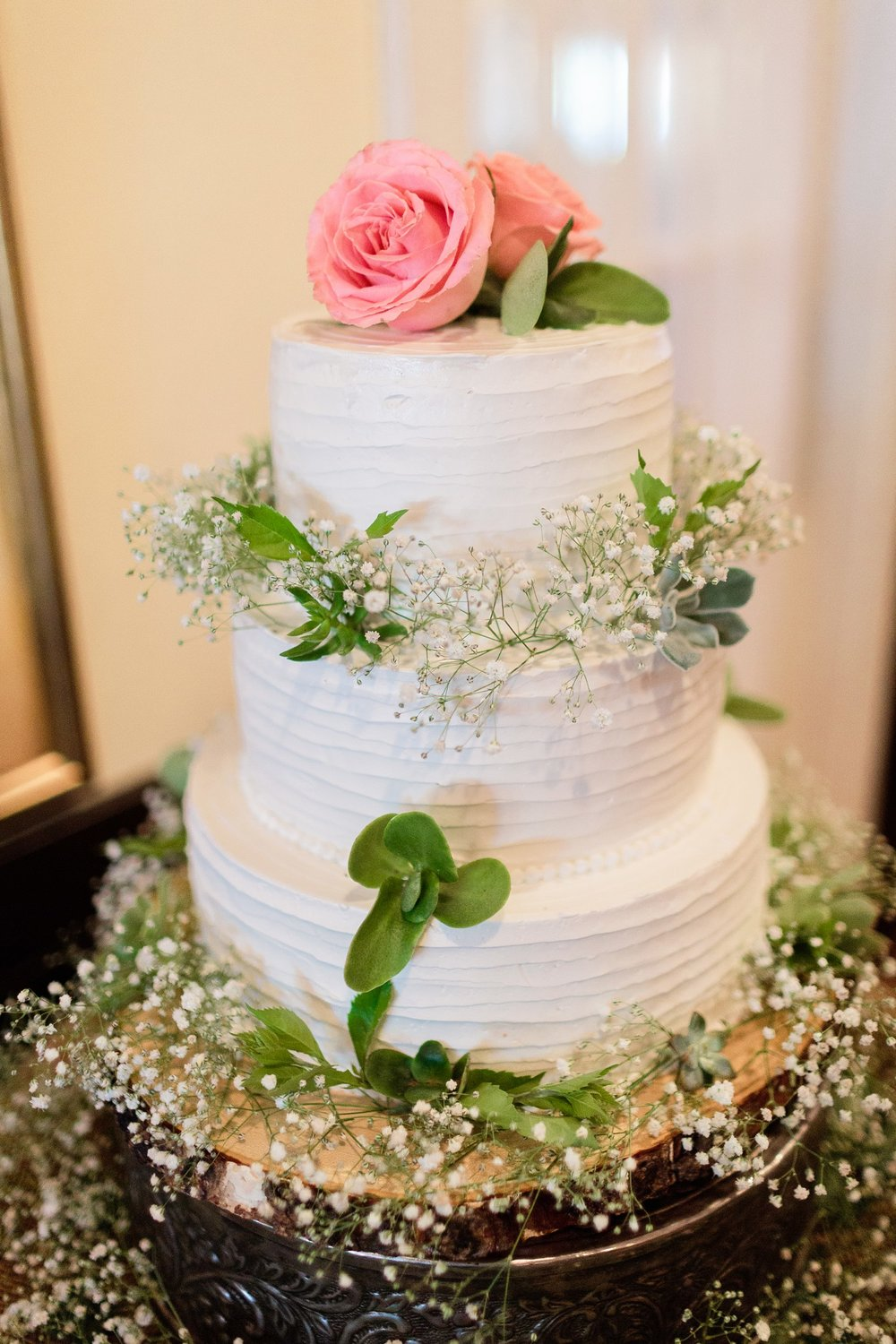 white wedding cake with rose and baby's breath santa barbara wedding