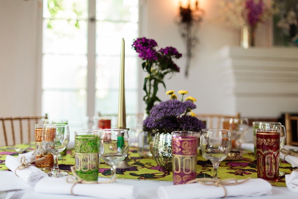 flowers candles and colored glass centerpieces los angeles wedding reception