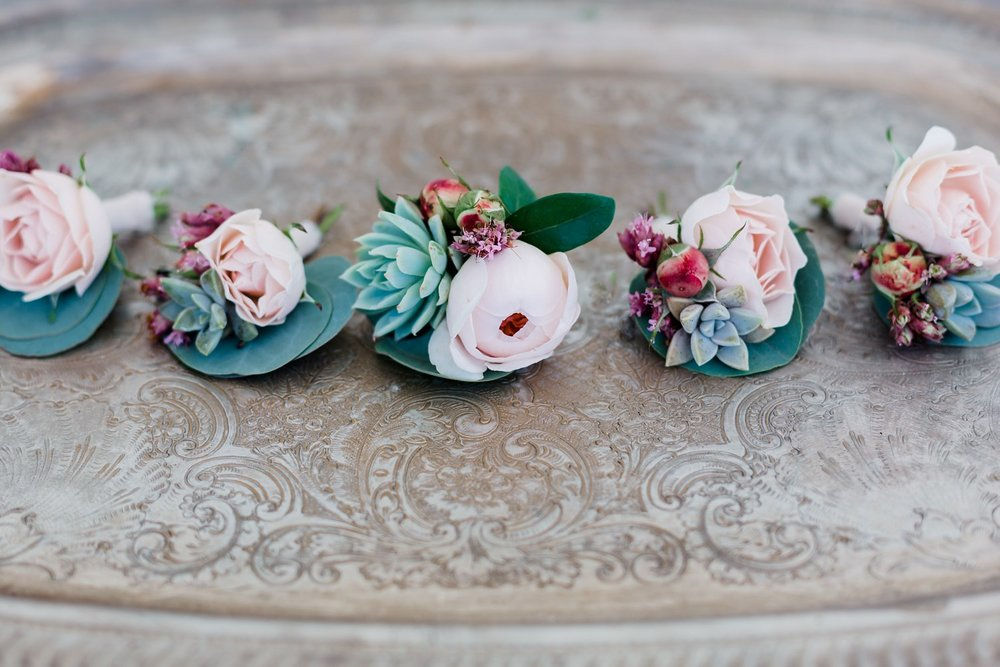 succulent boutonnieres at rancho dos pueblos wedding