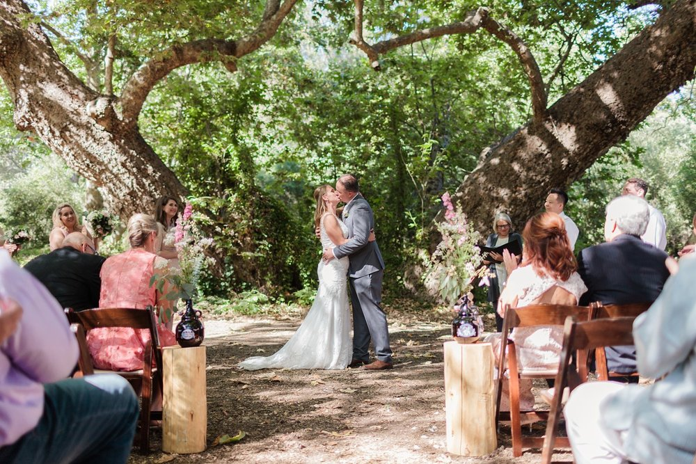 first kiss oak trees ceremony photography at rancho dos pueblos