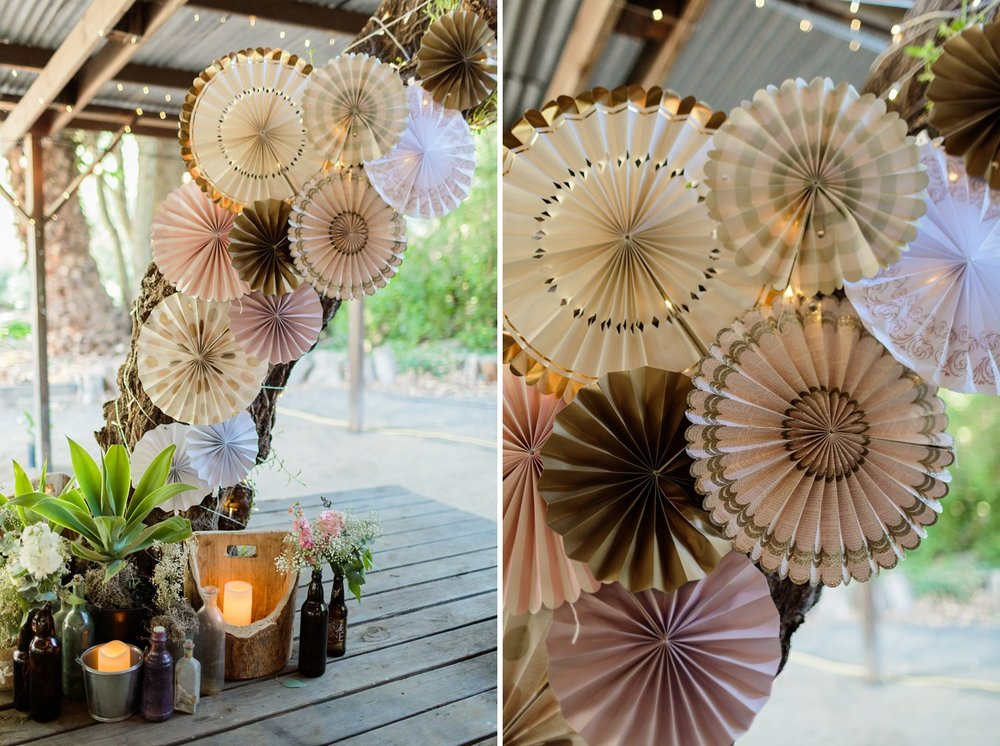 diy paper fans at wedding reception