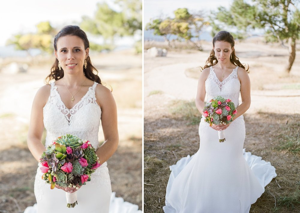 bride in stella york gown with succulent bouqet